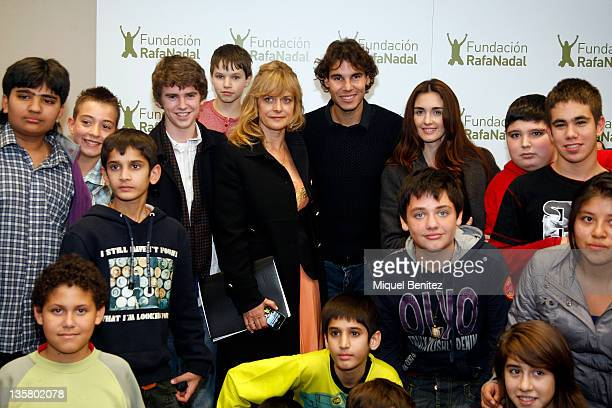Freddie Highmore Nastassja Kinski Rafa Nadal and Paz Vega pose with children during the presentation of the project 'Integration and Sport' sponsored...