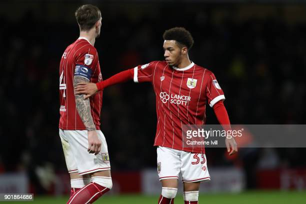 Freddie Hinds of Bristol City consoles Aden Flint of Bristol City during the Emirates FA Cup Third Round match between Watford and Bristol City at...
