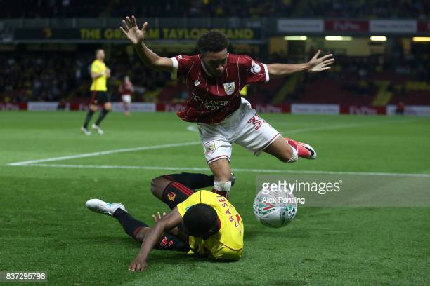 Freddie Hinds of Bristol City tussles with Christian Kabasele of Watford during the Carabao Cup Second Round match between Watford and Bristol City...