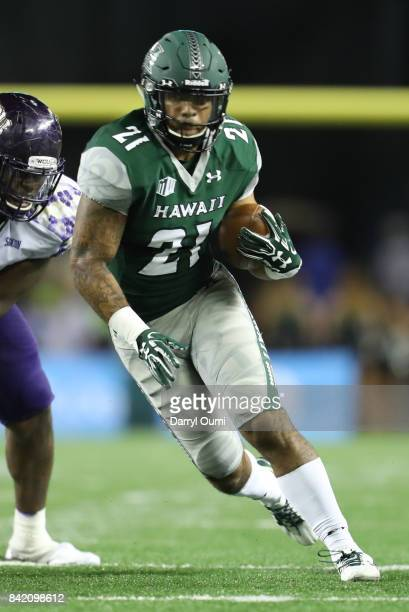 Freddie Holly III of the Hawaii Rainbow Warriors runs the ball in the fourth quarter of the game against the Western Carolina Catamounts at Aloha...