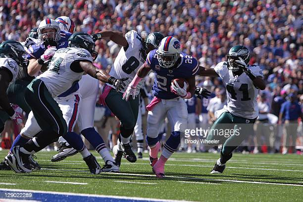 Freddie Jackson of the Buffalo Bills runs for a touchdown while Jamar Chaney Trevor Laws and Jarrad Page of the Philadelphia Eagles try to stop him...