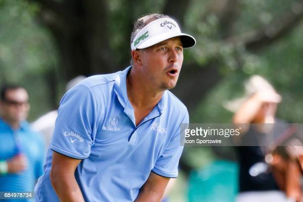 Freddie Jacobson of Sweden watches his shot from the trees on the hole during the first round of the ATT Byron Nelson on May 18 2017 at the TPC Four...