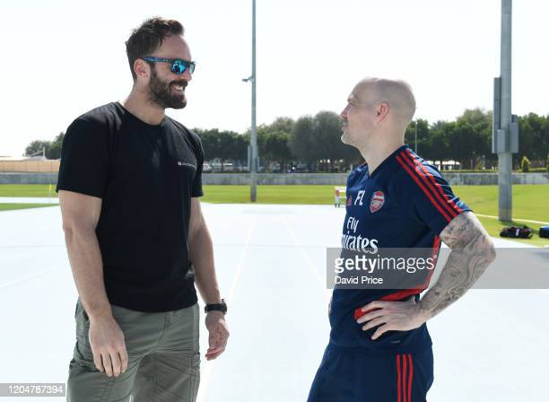Freddie Ljungberg Arsenal 1st team assistant coach chats to his former team mate Manuel Almunia the former Arsenal Goalkeeper after the Arsenal...
