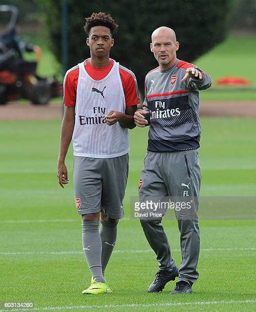 Freddie Ljungberg Arsenal coach chats to Chris Willock of Arsenal during the Arsenal UEFA Youth League Training Session at London Colney on September...