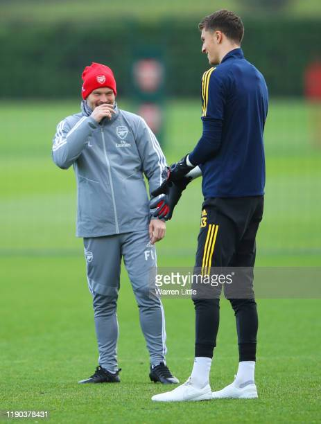 Freddie Ljungberg assistant manager of Arsenal and Matt Macey in dicussion during an Arsenal training session on the eve of their UEFA Europa League...