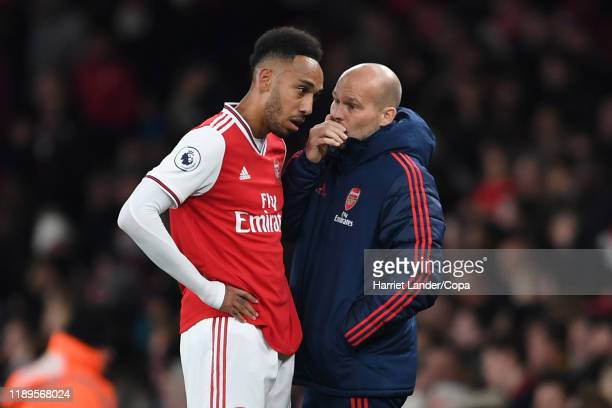 Freddie Ljungberg Assistant Manager of Arsenal gives instructions to PierreEmerick Aubameyang of Arsenal during the Premier League match between...