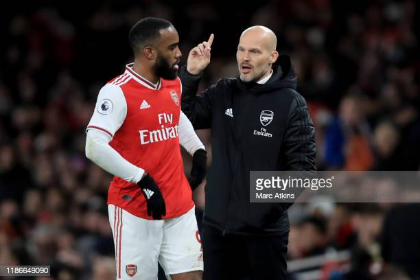 Freddie Ljungberg caretaker Arsenal coach speaks with Alexandre Lacazette during the Premier League match between Arsenal FC and Brighton Hove Albion...