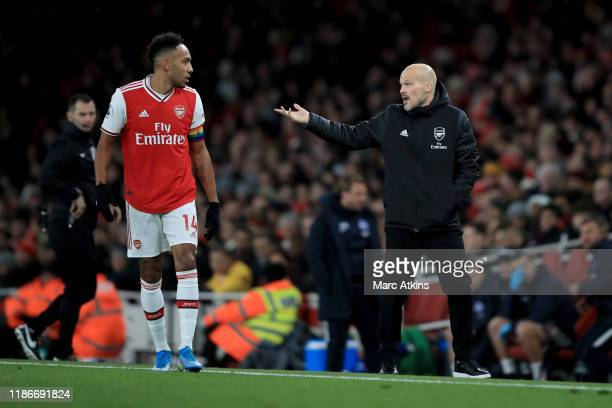 Freddie Ljungberg caretaker Arsenal coach speaks with PierreEmerick Aubameyang of Arsenal during the Premier League match between Arsenal FC and...