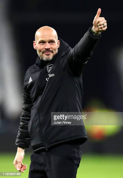 Freddie Ljungberg Interim Manager of Arsenal acknowledges the fans during the Premier League match between West Ham United and Arsenal FC at London...