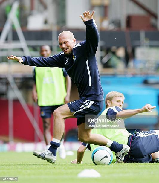 Freddie Ljungberg is tackled by Calum Davenport during the West Ham United Open Day training session at Upton Park on July 27 2007 in London England