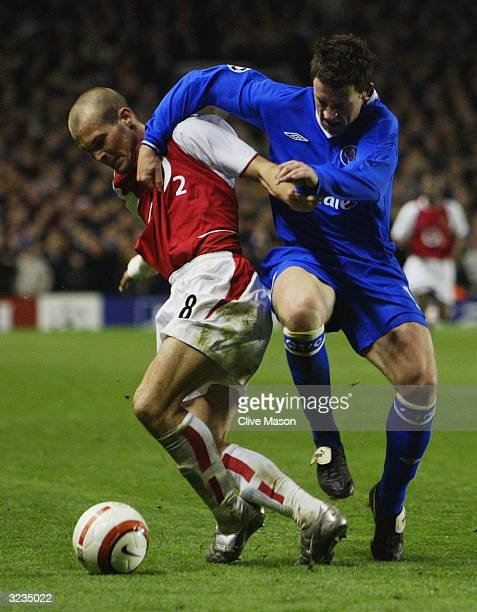 Freddie Ljungberg of Arsenal battles with Wayne Bridge of Chelsea during the UEFA Champions League Quarter Final Second Leg match between Arsenal and...
