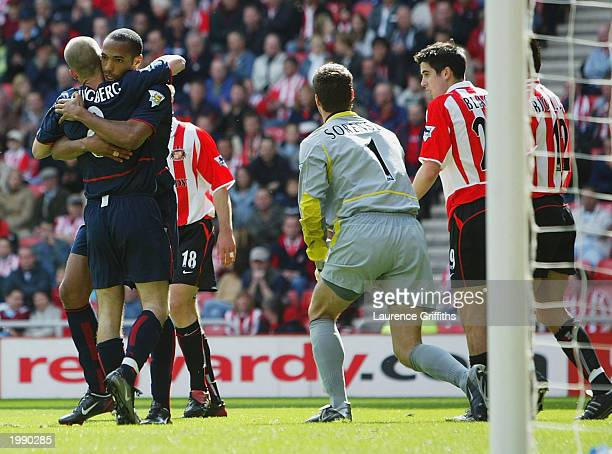 Freddie Ljungberg of Arsenal celebrates the second goal with Thierry Henry during the FA Barclaycard Premiership match between Sunderland and Arsenal...