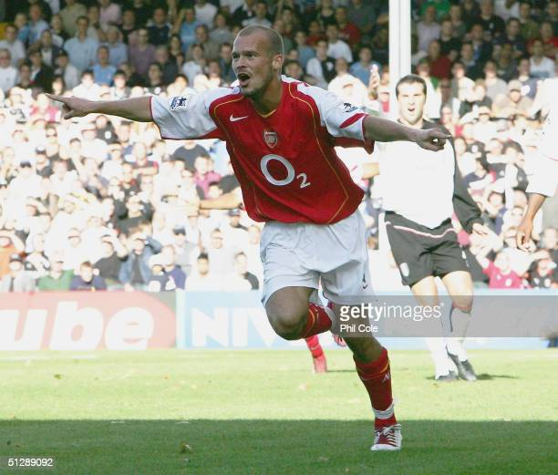 Freddie Ljungberg of Arsenal celkebrates scoring the first goal during the Barclays Premiership match between Fulham and Arsenal at Craven Cottage on...