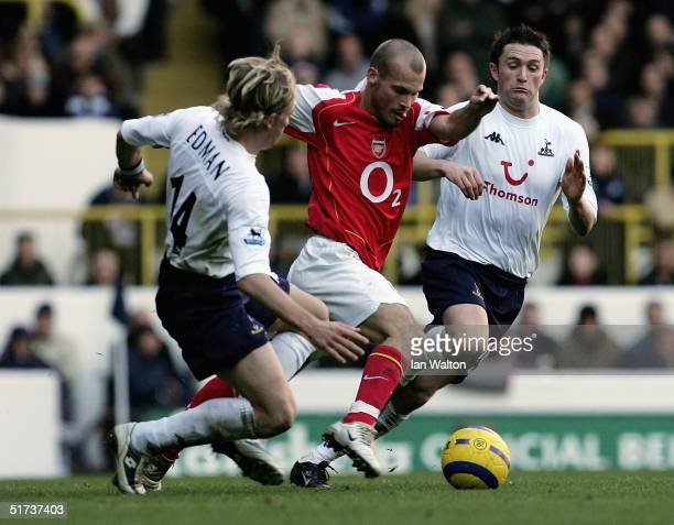 Freddie Ljungberg of Arsenal goes past Erik Edman of Tottenham Hotspur during the Barclays Premiership match between Tottenham Hotspur and Arsenal at...