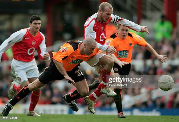 Freddie Ljungberg of Arsenal is brought down by Danny Cullip of Sheffield Utd during the FA Cup fifth round match between Arsenal and Sheffield...