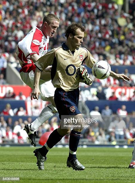 Freddie Ljungberg of Arsenal is challenged by John Curtis of Sheffield United during the FA Cup SemiFinal between Arsenal and Sheffield United on...