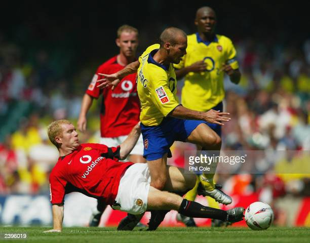 Freddie Ljungberg of Arsenal is tackled by Paul Scholes of Manchester United during the FA Community Shield match between Arsenal and Manchester...