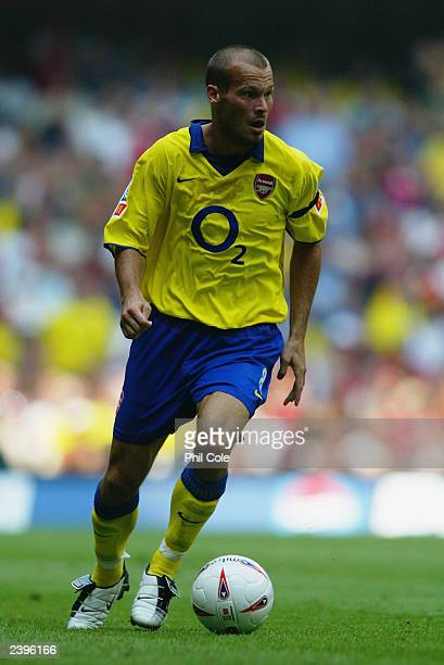 Freddie Ljungberg of Arsenal runs with the ball during the FA Community Shield match between Arsenal and Manchester United held on August 10, 2003 at...
