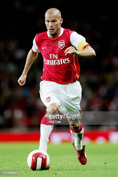 Freddie Ljungberg of Arsenal runs with the ball during the UEFA Champions League Qualification Third qualifying round second leg match between...