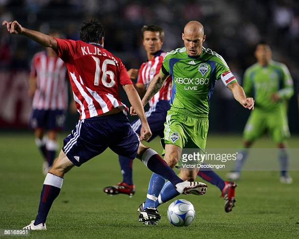 Freddie Ljungberg of Seattle Sounders FC dribbles the ball on the attack against Sacha Kljestan of Chivas USA during the MLS match at The Home Depot...