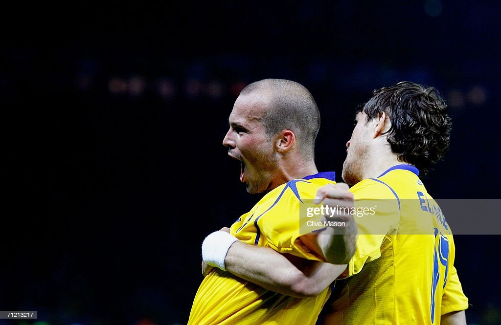 Freddie Ljungberg of Sweden celebrates scoring the winning goal with team mate Johan Elmander during the FIFA World Cup Germany 2006 Group B match between Sweden and Paraguay played at the Olympic Stadium on June 15, 2006 in Berlin, Germany.