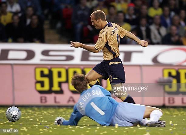 Freddie Ljungberg of Sweden goes round Ewin Van Der Sar of the Netherlands during the International Friendly match between Sweden and the Netherlands...