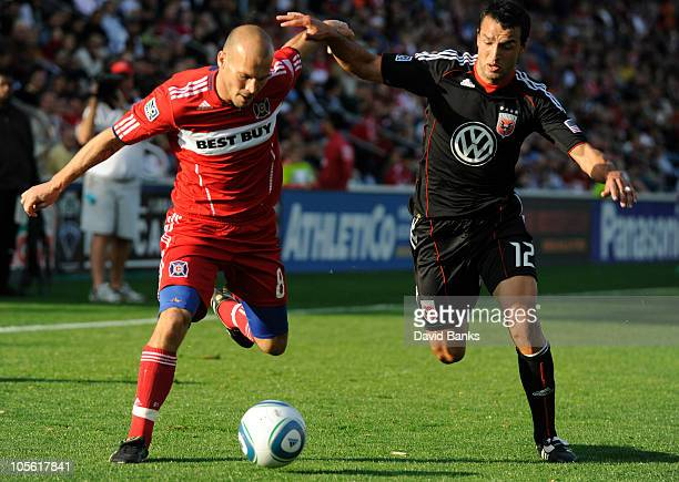 Freddie Ljungberg of the Chicago Fire and Jed Zayner of DC United fight for the ball in an MLS match on October 16 2010 at Toyota Park in Bridgeview...