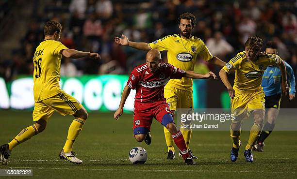 Freddie Ljungberg of the Chicago Fire moves up the field against Robbie Rogers Adam Moffat and Brian Carroll of the Columbus Crew in an MLS match on...