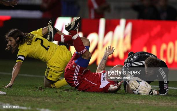 Freddie Ljungberg of the Chicago Fire protests after being tripped in the box by Frankie Hejduk of the Columbus Crew as William Hesmer makes the save...