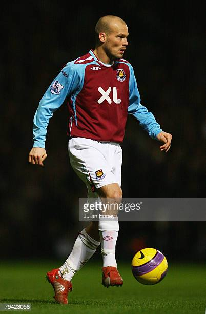 Freddie Ljungberg of West Ham controls the ball during the Barclays Premier League match between West Ham United and Liverpool at Upton Park on...