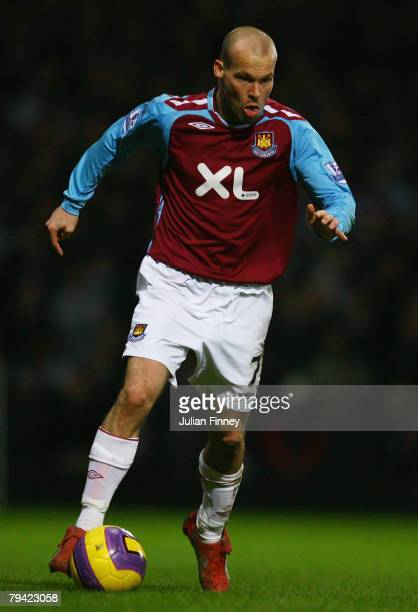 Freddie Ljungberg of West runs with the ball during the Barclays Premier League match between West Ham United and Liverpool at Upton Park on January...