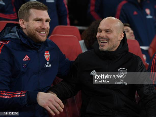 Freddie Ljungberg the Arsenal Interim Head Coach with Per Mertesacker the Interim Assistant Coach before the Premier League match between Arsenal FC...