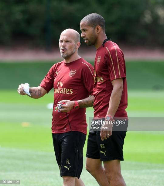 Freddie Ljungberg the Arsenal U23 Head Coach chats to his assistant Ryan Garry during Arsenal U23 Training Session at London Colney on July 9 2018 in...