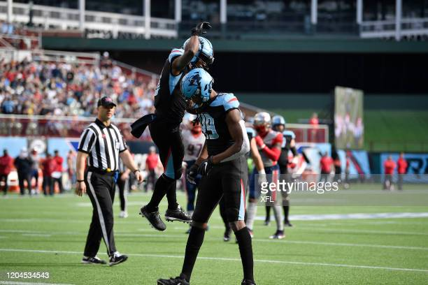 Freddie Martino and Donald Parham of the Dallas Renegades celebrate after a touchdown during the XFL game against the Houston Roughnecks at Globe...