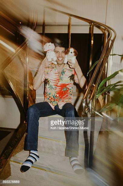 Freddie Mercury holding a stuffed dog in a hotel Tokyo April 1979