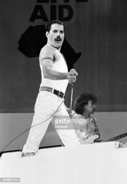 Freddie Mercury, lead singer of British rock group Queen, performing on stage at Wembley Stadium during the Live Aid concert. 13th July 1985.