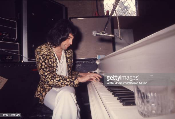 Freddie Mercury of Queen at a white grand piano during rehearsing and recording of 'A Night At The Opera' album at Ridge Farm Studios, West Sussex,...