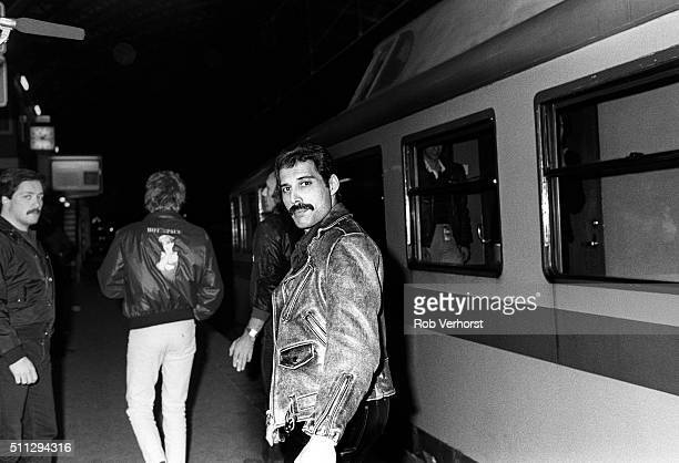 Freddie Mercury of Queen by a train from Leiden to Amsterdam Netherlands after a gig at Groenoordhal Leiden 25th April 1982
