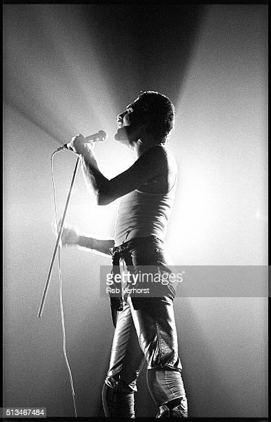 Freddie Mercury of Queen in silhouette performing on stage at Groenoordhal Leiden Netherlands 27th November 1980