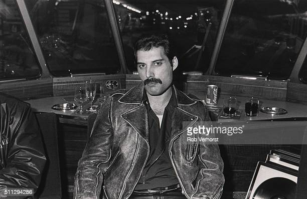 Freddie Mercury of Queen on board a train from Leiden to Amsterdam Netherlands after a gig at Groenoordhal Leiden 25th April 1982