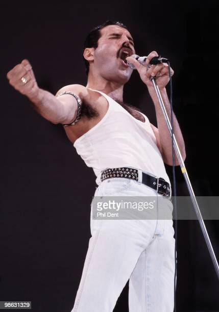 Freddie Mercury of Queen performs on stage at Live Aid at Wembley Stadium on 13th July 1985 in London