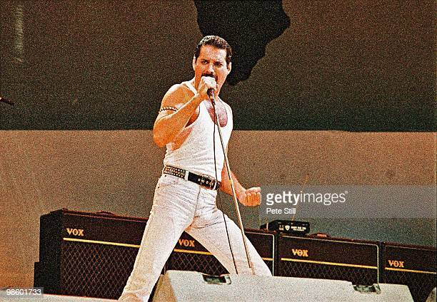 Freddie Mercury of Queen performs on stage at Live Aid on July 13th, 1985 in Wembley Stadium, London, England