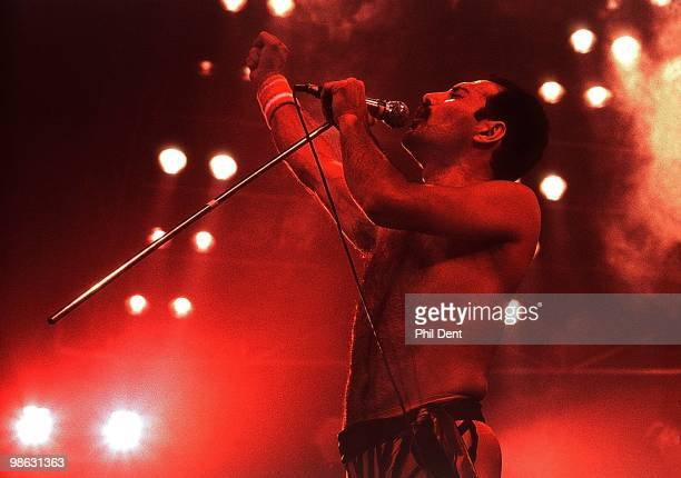 Freddie Mercury of Queen performs on stage at Wembley Arena on 4th September 1984 in London