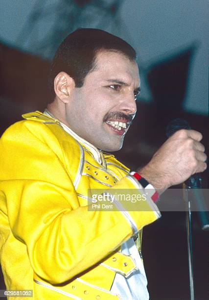 Freddie Mercury of Queen performs on stage Wembley Stadium London 1986