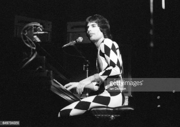 Freddie Mercury of Queen plays the piano while performing on stage on the 'A Night At The Opera Tour' tour, Hammersmith Odeon, London, 29 November...
