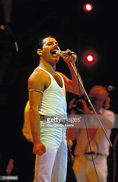 Freddie Mercury of Queen sings during the Live Aid concert at Wembley Stadium on 13 July 1985 in London England
