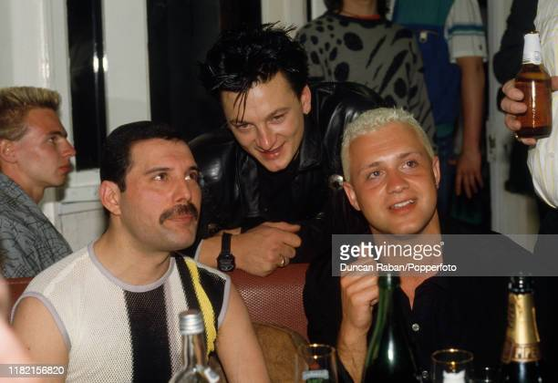 Freddie Mercury of Queen with fellow musicians Mark O'Toole of Frankie Goes to Hollywood and Belouis Some at the Queen Boat Party during the Golden...