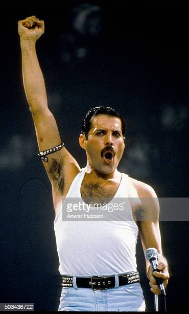 Freddie Mercury of the group Queen performs at the Live Aid concert on July 13 1985 in London England