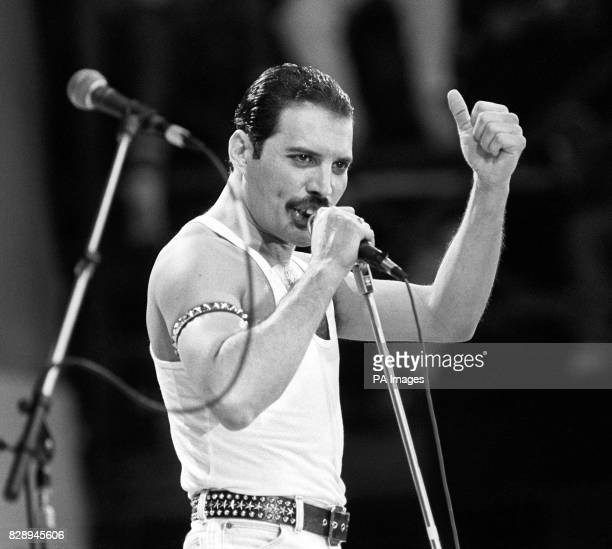 Freddie Mercury of the pop band Queen performing on stage during the Live Aid concert