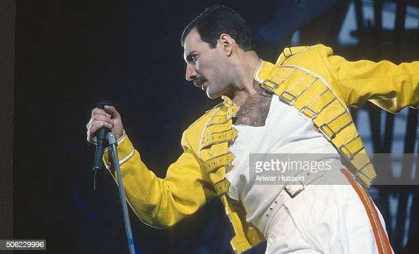 Freddie Mercury of the rock group Queen perfumes at a concert on January 01 1986 in London England